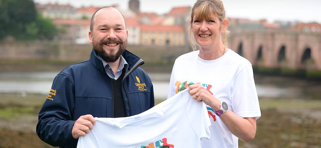 Richard Simpson holding Berwick's Curfew Run t-shirt with member of Berwick's Curfew Run