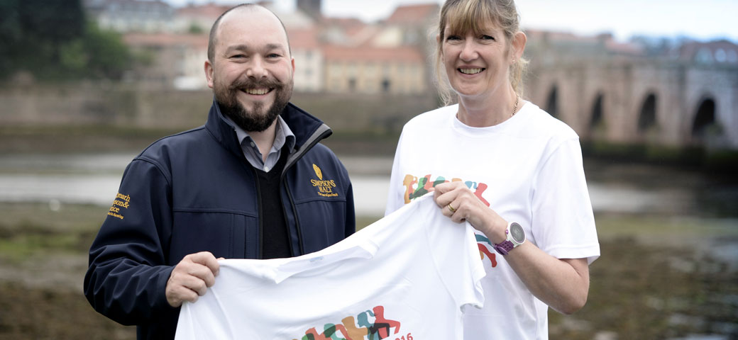 Richard Simpson holding Berwick's Curfew Run t-shirt with Berwick's Curfew Run member