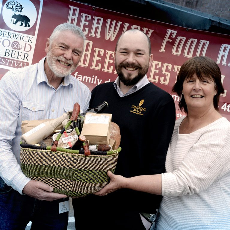 Richard Simpson and others holding food basket at Berwick Food and Beer Festival